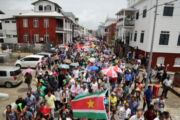 Demonstrators shout slogans during a protest against the administration of President Desi Bouterse in Paramaribo