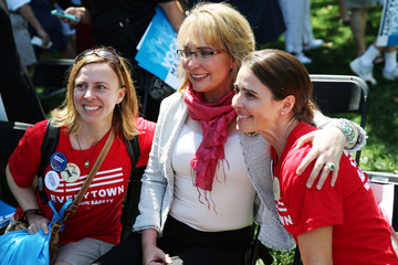Representative Gabby Giffords (D-AZ) poses with supporters at a gun control rally on the second day of the Democratic National Convention in Philadelphia