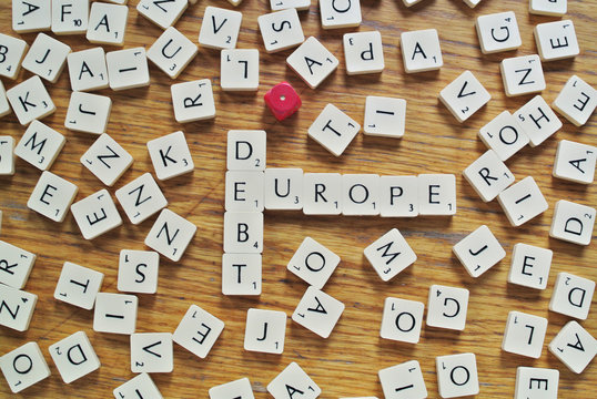 The words debt and Europe, made from letters of a scrabble game, are seen in this illustration picture taken in Ljubljana