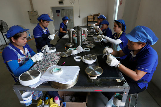 Employees arrange blades for construction at an assembly line at Gang Yan Diamond Tools, a Chinese manufacturing plant, located in the Thai-Chinese Rayong Industrial Zone