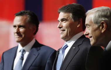 Romney, Perry and Paul stand on stage before the Reagan Centennial GOP presidential primary debate in Simi Valley, California