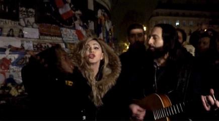 A still image from a video shows singer Madonna giving an impromptu street concert at the Place de la Republique in Paris