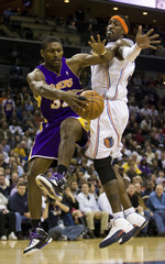 Los Angeles Lakers forward Artest passes ball against Charlotte Bobcats forward Wallace during an NBA basketball game in Charlotte