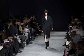 A model presents a creation by Portuguese designer Oliveira Baptista as part of his Fall-Winter 2013/2014 women's ready-to-wear fashion show during Paris fashion week