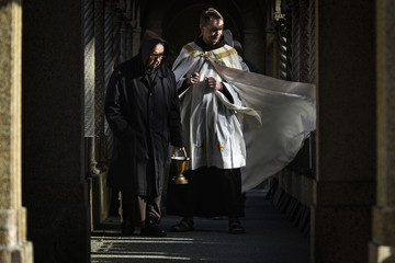 Brother Roger Petras and Father Larry Dunham lead a procession blessing candles in a Christmas tradition at the Franciscan Monastery in Washington