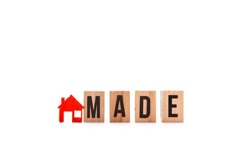 Home Made - block letters with red home / house icon with white background
