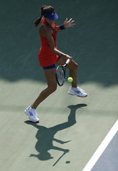 Ivanovic of Serbia hits a return to Dulgheru of Romania at the U.S. Open tennis championships in New York