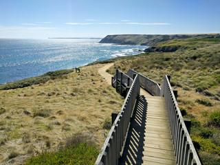Ocean view on Phillip Island with wooden pathway, Victoria, Australia