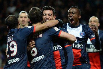 Paris Saint-Germain's Javier Pastore celebrates with team mates after scoring against Monaco during their French Ligue 1 soccer match at the Louis II stadium in Monaco