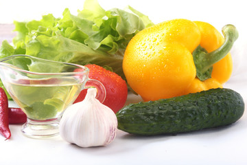 Assorted vegetables, fresh bell pepper, tomato, chilli pepper, cucumber, olive oil, garlic and lettuce isolated on white background. Selective focus.