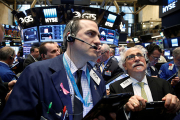 Traders gather for the opening of LinkedIn Corp. at the post where it is traded on the floor of the New York Stock Exchange in New York City
