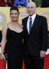 Actor Patrick Stewart and a guest arrive at the 17th annual Screen Actors Guild Awards in Los Angeles