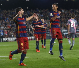 Barcelona's Neymar (R) and Luis Suarez (L) celebrate a goal against Rayo Vallecano during their Spanish first division soccer match at Camp Nou stadium in Barcelona