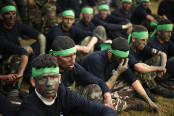 Palestinian students take part in a graduation ceremony for a military-style training programme in Gaza City