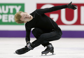 Andrei Rogozine of Canada skates during practice sessions at the ISU World Figure Skating Championships in London, Ontario