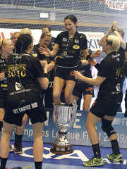 Players of Denmark's Viborg HK celebrate after their women's final handball match against Romania's C.S. Oltchim Valcea of the EHF Champions League tournament in Bucharest