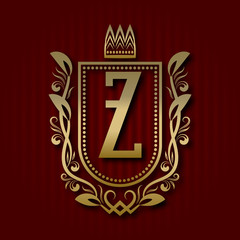 Golden royal coat of arms in medieval style. Vintage logo with Z monogram.