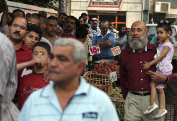 People queue to vote during Egypt's presidential elections in the Mediterranean city of Alexandria