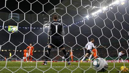 Netherland's goalkeeper Maartem Stekelenburg reacts on Germany's second goal during their friendly soccer match in Hamburg
