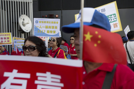 Pro-China supporters attend a rally against the Occupy Central Movement and in support of the government's consultation report on methods for electing the Chief Executive in 2017, in Hong Kong