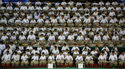 Students play the tabla, an Indian percussion instrument, in an attempt to set a new Guinness World Record in the western Indian city of Ahmedabad