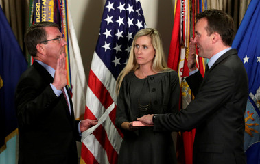 U.S. Defense Secretary Ash Carter swears-in new Army Secretary Eric Fanning during a ceremony at the Pentagon in Washington