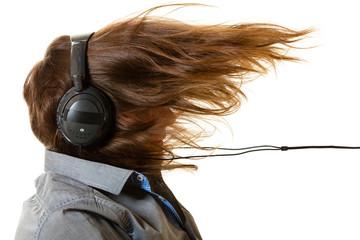 Man listening to music on headphones, windblown hair
