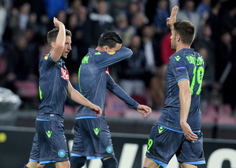 Napoli's Mertens celebrates with his teammate Lopez after scoring against VfL Wolfsburg during their Europa League quarter-final second leg soccer match at San Paolo stadium in Naples
