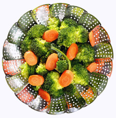 Broccoli and sliced carrots on stainless steel steamer. Steamed vegetables.