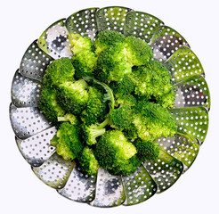 Broccoli on stainless steel steamer. Steamed broccoli.
