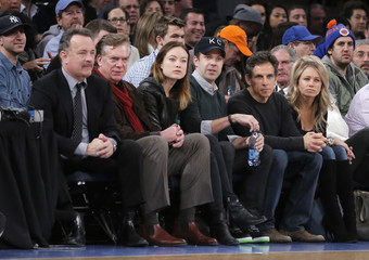 Actors Tom Hanks, Christopher McDonald, Olivia Wilde, Jason Sudeikis, Ben Stiller and Christine Taylor watch New York Knicks play Los Angeles Clippers in NBA game in New York