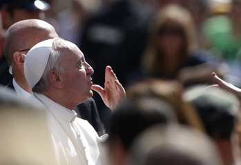 Pope Francis sends a kiss as he arrives to lead his Wednesday general audience in St Peter's Square at the Vatican