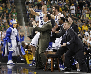 Duke's Plumlee and Zoubek celebrate in the final minutes of their team's victory against Baylor during their NCAA South Regional college basketball game in Houston