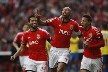 Benfica's Silva celebrate his goal against Estoril with teammates Garay and Machado during their Portuguese premier league soccer match in Lisbon