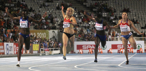 Verena Sailer of Germany crosses the finish line to win the women's 100 metre final at the European athletics championships at the Olympic stadium in Barcelona