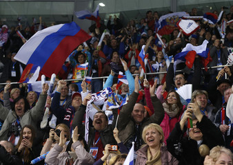 Russian team supporters celebrate as their team won their women's ice hockey game over Germany at the 2014 Sochi Winter Olympics