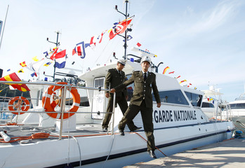 Officers from the Tunisian National Guard step off a patrol boat at Sidi Bou Said port