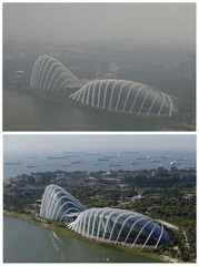 Combination photo shows the view of the Flower Dome and Cloud Forest conservatories of Gardens by the Bay and the southern coast of Singapore on a hazy day and on a clear day