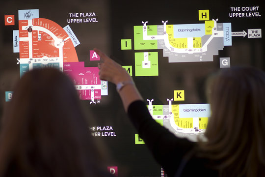 Shoppers refer to a map at the King of Prussia Mall, United State's largest retail shopping space, in King of Prussia