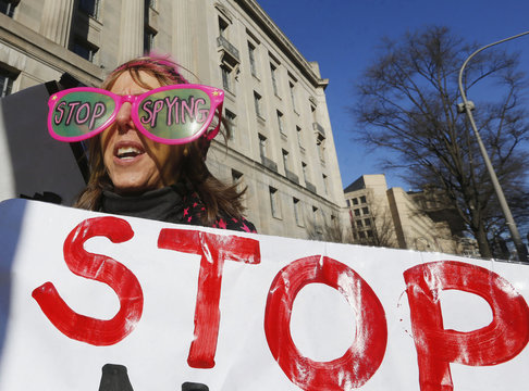 The founder of protest group Code Pink Benjamin wears large sunglasses as she protests against U.S. President Obama and NSA before his arrival at Department of Justice in Washington