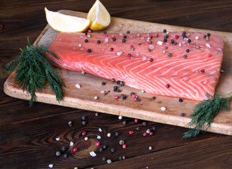 Fresh salmon fillet with aromatic herbs and spices