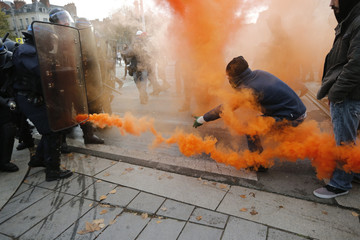 """Protestors taunt French riot police with smoke safety flares as the attend a protest demonstration against """"police brutality"""" in Nantes"""