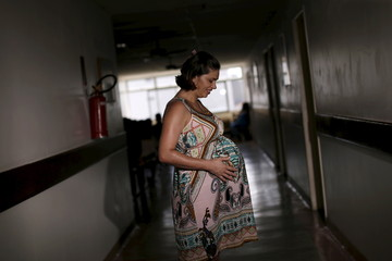Juliana Gomes, who is eight months pregnant, poses for a picture at the IMIP hospital in Recife