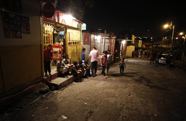 People wait to receive food in Triangulo de la Solidaridad, a low-income neighborhood, north of San Jose