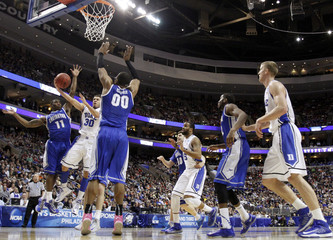 Duke Blue Devils' Curry shoots between Creighton Bluejays' Yates and Echenique during their third round NCAA tournament basketball game in Philadelphia