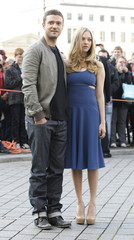 Cast members Timberlake and Seyfried pose photographers next to Brandenburger Tor in Berlin