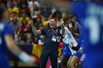 France's coach Olivier Krumbholz reacts on the sideline of their women's handball quarterfinals match against Montenegro at the Copper Box venue during the London 2012 Olympic Games