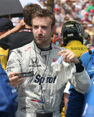 Driver Hinchcliffe gestures before the 100th anniversary of Indianapolis 500 auto race in Indianapolis