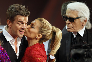 "TV host Lanz receives a kiss during the German game show ""Wetten Dass"" (Bet it...?) in the western German town of Duesseldorf"