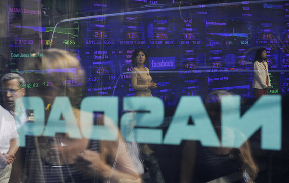 The Facebook logo is seen on the screen inside the Nasdaq Market site in New York
